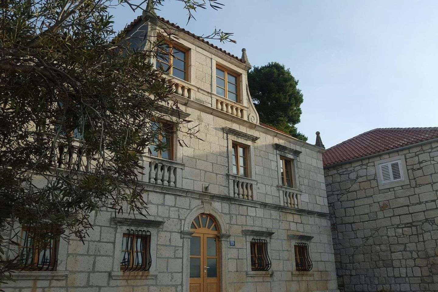 18th century stone seaside palace, surrounded by pine forest