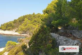 Building land in a quiet bay on the west coast of Korčula island, first row to the sea