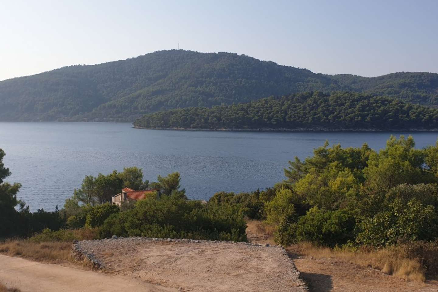 Building land in a quiet bay first row to the sea, Tudorovica