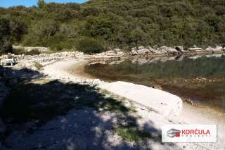 Building land in a quiet and hidden bay, first row to the sea, unique opportunity, close proximity to Korčula town